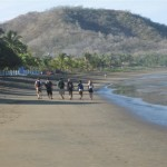 Students walking down beach